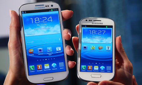 """File photo shows models holding a Samsung """"Galaxy S3"""" and the """"Galaxy S3 mini'  phones in Frankfurt"""